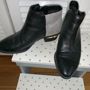 Same Edelman booties with gold spike detail.